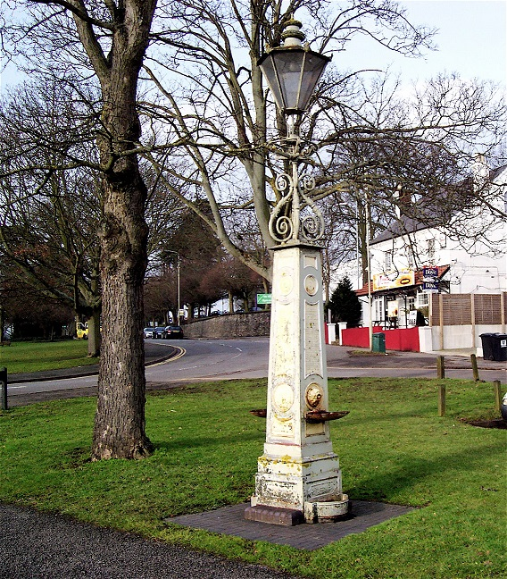 19th century stone drinking fountain with lamp, outside Boxmoor Hall | Lionel Howard