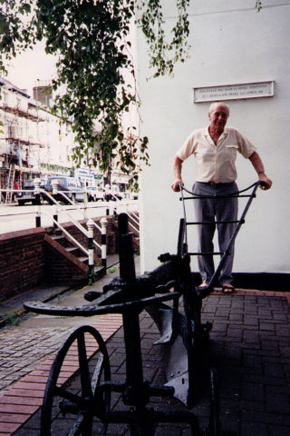 Len Lane, great-grandson of James Davis-the founder of Boxmoor Ironworks, on a visit to Hemel Hempstead in 1995, proudly standing beside the plough made by his ancestors | Helen Belcher