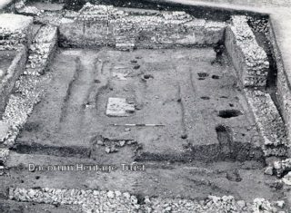 Excavations of Gadebridge Roman Villa, This view is looking north to the south-east wing. The masonry stands in the room and originally supported a wall that separated the corridor and rooms in the upstairs storey | Dacorum Heritage Trust