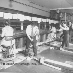 The installation of an automatic telephone exchange at John Dickinson's. The staff continue to work as the manual board is removed | Dacorum Heritage Trust