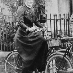 Miss Letita Lurrel on a bicycle outside her house in Alexandra Road, Hemel Hempstead, late 1800s. Notice the extra guard under the mud guard which would prevent the skirt becoming trapped in the spokes of the wheel. | Dacorum Heritage Trust