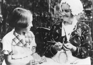 Mrs. Watts, born Rosina Delderfield in 1862, showing her grand-daughter how to plait | The Dacorum Heritage Trust