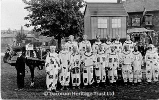 Getting ready for the Hospital Parade on the Moor (opposite the former Baptist Church on London Road).  Local people regularly contributed to the West Herts. Hospital and processions were a popular part of their fundraising efforts   Dacorum Heritage Trust