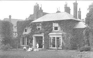 Exterior of the Old House, photo by Edward Sammes c. 1913.  The Institute bought the listed building in 1919 and formed a Sports and Social section, later to be known as the Hemel Hempstead Club.  The ground floor was mostly let out for offices.  A large part of the grounds was sold in 1930 for the shops to be built on The Parade | Dacorum Heritage Trust Ltd