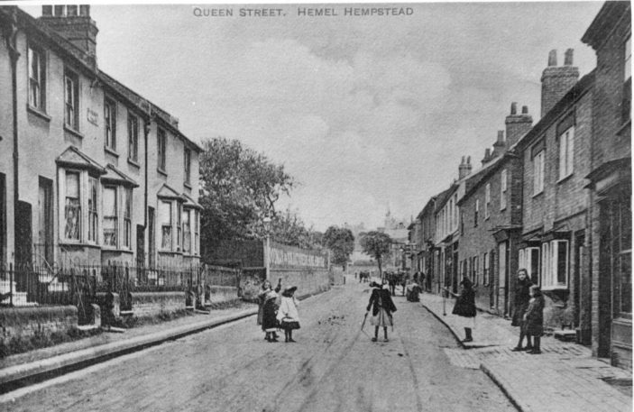 Children at play in Queen Street, Hemel Hempstead | Not sure.  It appears to be an old postcard