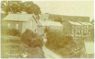 The bottom end of Trowley Hill Road c.1904 with the Primitive Methodist  Chapel on the left and the outbuildings of the Blue Boar bottom right. Trowley Hill  Farm Barn fills the horizon | Mary Mealey