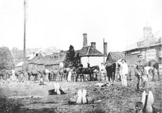 Upper Mill and Edward VI public house with the horses of the Inns of Court Officer Training in the foreground. IN 1922 the Edward VI closed and became a private house before being demolished in 1960. The pub had once been known as the Clown and Sausages and the loft had been used as a thrashing barn | Berkhamsted Local History and Museum Society cared for by the Dacorum Heritage Trust