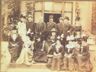 Lt. Commander Henry Theophilus Smith-Dorrien (back row centre, with bowler hat) pictured with his mother, Mary Ann Smith-Dorrien (nee Drever). | Dacorum Heritage Trust