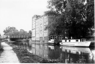 A view across the canal from the towpath, looking towards Castle Mill on Lower Kings Road | Berkhamsted Local History and Museum Society cared for by the Dacorum Heritage Trust