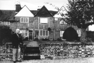 Arthur Lindley in front of Cottages at Piccotts End with Medieval Wall Paintings | Berkhamsted Local History and Museum Society cared for by The Dacorum Heritage Trust Ltd