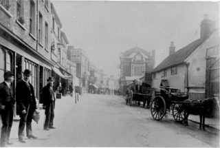 High Street showing the Red Lion and the three balls sign of the pawnbroker's shop   Hemel Hempstead Local History and Museum Society cared for by the Dacorum Heritage Trust Ltd