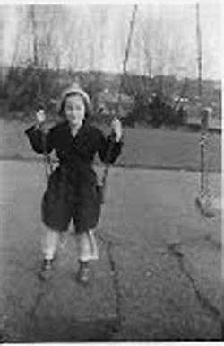 Lesley on the swings