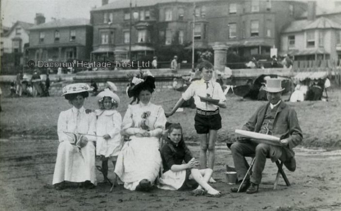 Group of people on the beach, Isle of Wight, 1907 | Dacorum Heritage Trust